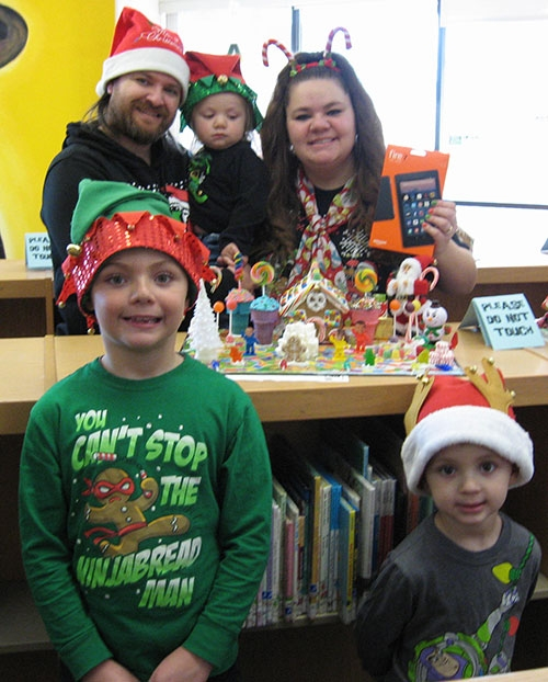 The top entries in the Gingerbread House Decorating Contest recently hosted by Robey Memorial Library in Waukon are pictured in the surrounding...